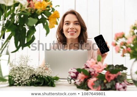 Fiorista signora piedi fiori Foto d'archivio © deandrobot