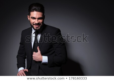 Picture closeup of working business man with tied hair looking a Stock photo © deandrobot