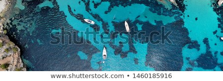 Drone point of view aerial photo moored yachts on the bright blu Stock photo © amok