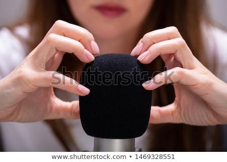 Mulher unhas microfone fundo escove Foto stock © AndreyPopov