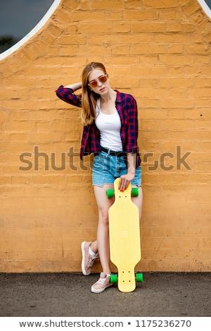 teenage girls with short skateboards in city Stock photo © dolgachov