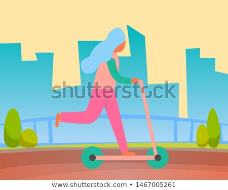 Woman Riding on Two Wheeled Open Motor Vehicle Stock photo © robuart