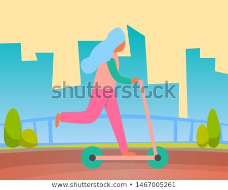 Kobieta jazda konna dwa otwarte parku Zdjęcia stock © robuart