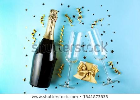 Pezsgő üveg arany konfetti rózsaszín papír Stock fotó © Illia