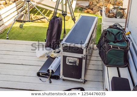 Video production gear on a set - big cinema lights and light rigging system. Stock photo © galitskaya
