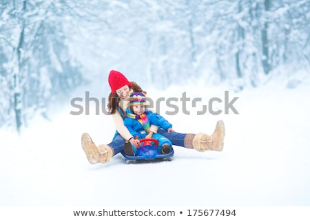 Mother And Daughter Enjoying Sledge Ride In Winter Park Stock photo © AndreyPopov