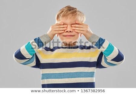 мальчика полосатый свитер глазах рук Сток-фото © dolgachov
