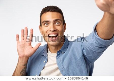 Surpreendido homem ver alguém câmera Foto stock © benzoix