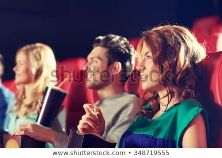 redhead teenage girl with popcorn at movie theater Stock photo © dolgachov