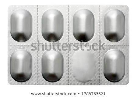 Tabletták kapszula műanyag fehér antibiotikum vitaminok Stock fotó © DenisMArt