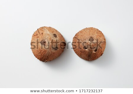 Two halves of fresh natural organic coconut fruit on a light grey background. Stock photo © artjazz