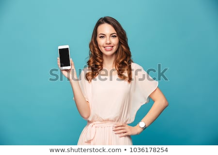 a lovely young woman showing mobile phone stock photo © zurijeta