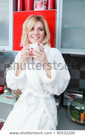 thirsty young blond woman stock photo © lithian