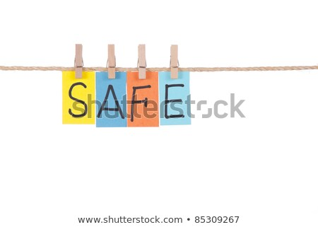 safe wooden peg and colorful words stock photo © ansonstock