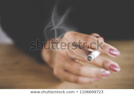 female smoker woman with smoke cigarette Stock photo © lunamarina