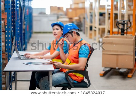 Man sitting at a desk in a depot Stock photo © photography33
