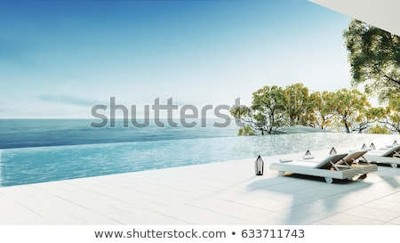 Couple relaxing on sofa by the pool Stock photo © photography33