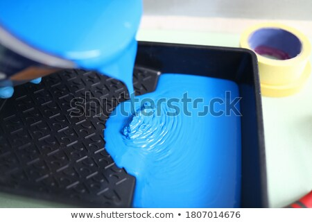 painter at work pouring paint from can into tray Stock photo © photography33