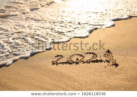happy · new · year · yazılı · kum · plaj · parti · sevmek - stok fotoğraf © yurikella