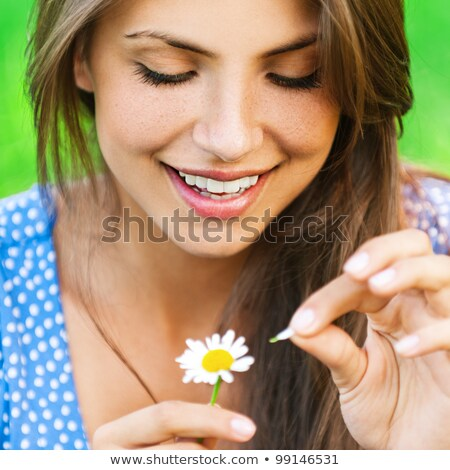 Woman wonders with chamomile Stock photo © pzaxe