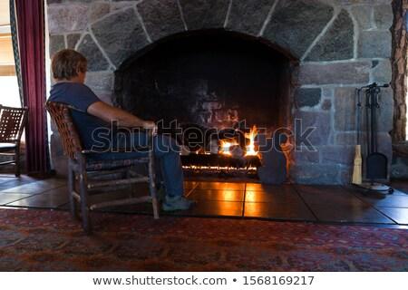 Adam rahatlatıcı halı sıcak taşlar çıplak Stok fotoğraf © stockyimages
