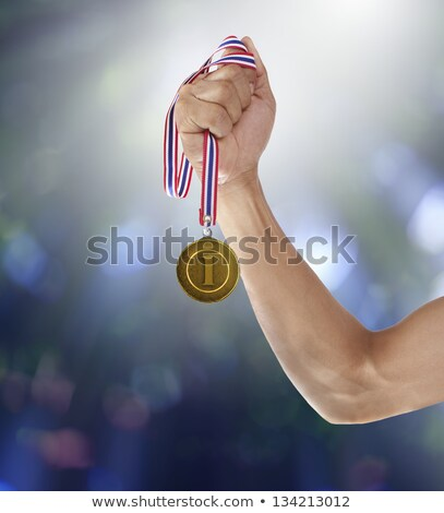 body with gold medal Stock photo © ssuaphoto