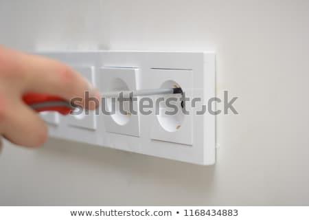 Stockfoto: Elektricien · muur · stopcontact · vrouw · hand