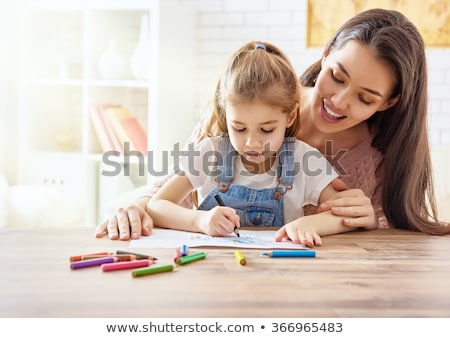 Family drawing with colourful pen Stock photo © wavebreak_media