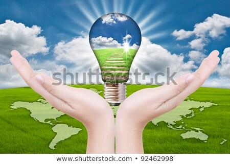 smiling business man pushing a light bulb button stock photo © feedough