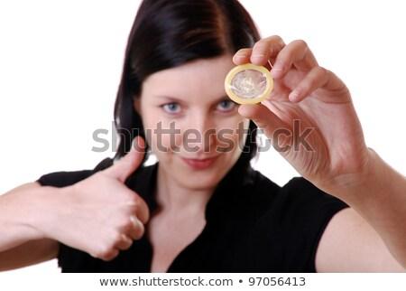 Thumbs up, condom on thumb Stock photo © michaklootwijk