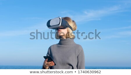 Technology concept. Businessman with biboculars and virtual inte Stock photo © HASLOO