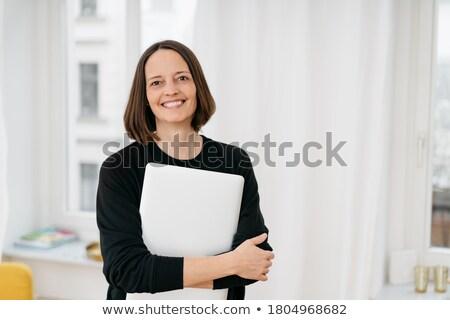 Businesswoman clutching her laptop Stock photo © stryjek