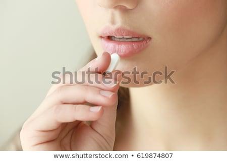 таблетки фотография женщины языком таблетка Сток-фото © jayfish