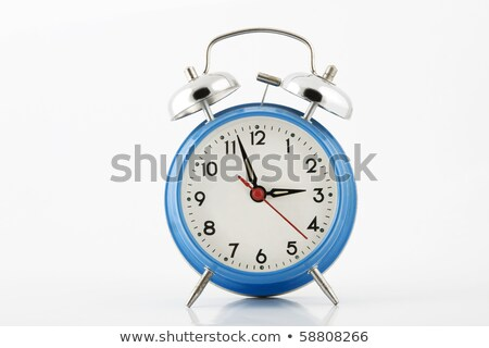 Close Up Of A Blue Bell Clock Alarm Clock Isolated On White Ba Photo stock © caimacanul
