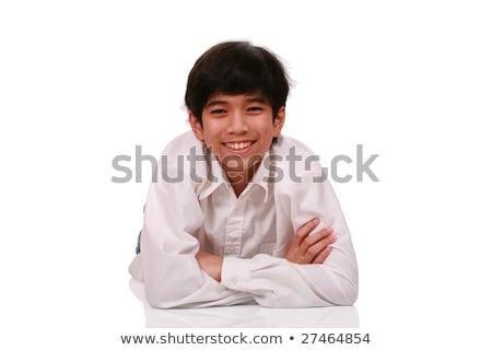 Jóképű tini fiú mosolyog fekszik fiatal Stock fotó © jarenwicklund