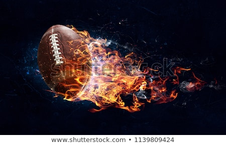 flaming american football stock photo © krisdog