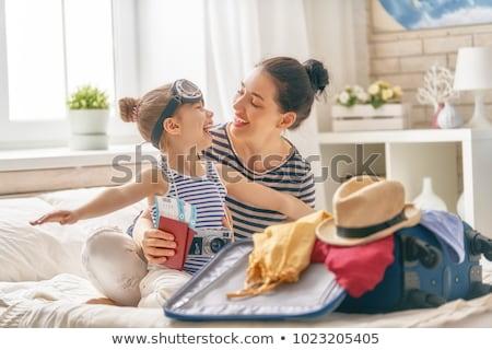 Girl preparing for summer vacation Stock photo © Elnur