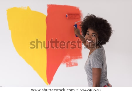 Pretty woman painting her house Stock photo © Aikon
