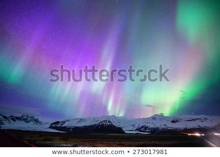 Northern lights (aurora borealis) display by night Stock photo © meinzahn