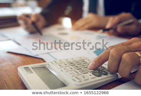 businessman - presenting calculator stock photo © dgilder