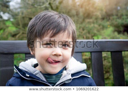 Portrait of a boy licking his lips Stock photo © bmonteny