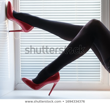 Seductive woman in black tights and red stilettos Stock photo © juniart