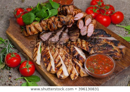 Platter of mixed meats, salad and French fries Stock photo © juniart