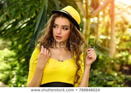 Closeup portrait of an alluring woman with lush hairstyle Stock photo © majdansky