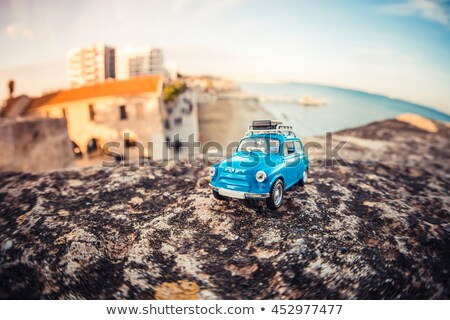 Miniature travelling car with luggage on a roof. Stock photo © Kirill_M