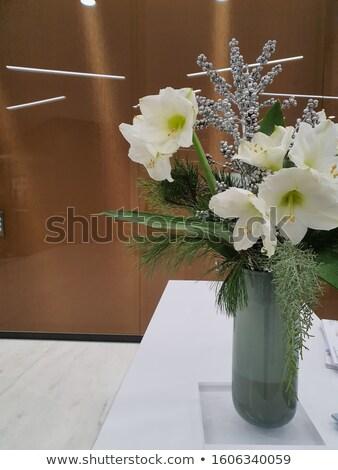 Fehér virágok egyezség üveg fehér fém asztal Stock fotó © art9858