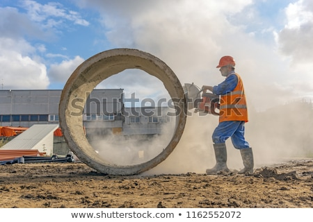 Plumbers cutting concrete water pipes Stock photo © stoonn