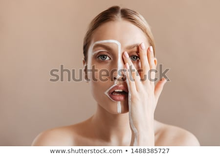 young blond woman covering her face stock photo © stryjek