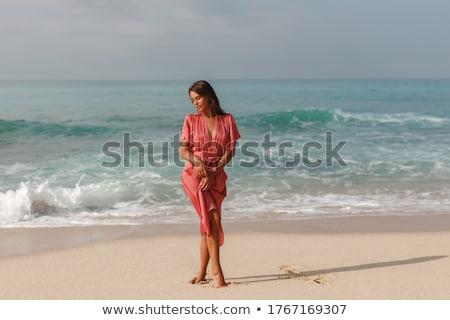 Walking on the beach at sunset Stock photo © Komar