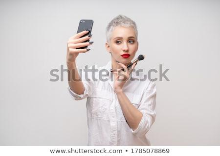 Studio portrait of beautiful trendy girl Stock photo © artfotodima